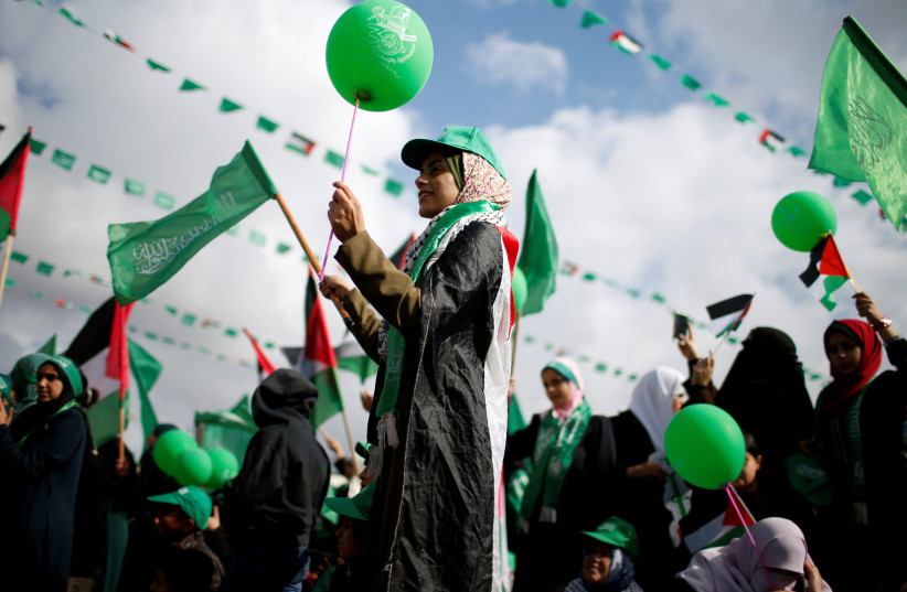 Palestinians supporting Hamas take part in a rally marking the 30th anniversary of Hamas' founding, in Gaza City December 14, 2017 (photo credit: MOHAMMED SALEM/REUTERS)