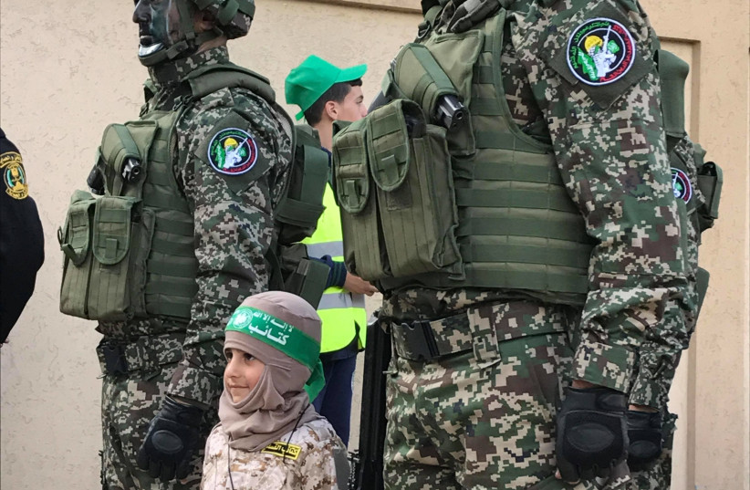Young girl in Gaza City during celebrations for Hamas' 30th anniversary   (photo credit: Courtesy)