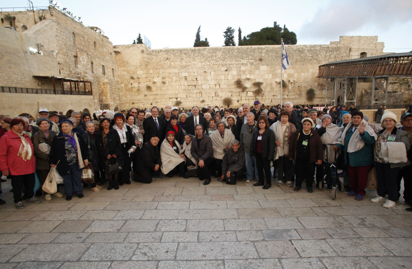 Hanukka candle-lighting ceremony in honor of Holocaust survivors at the Western Wall in Jerusalem (photo credit: RAANAN COHEN)