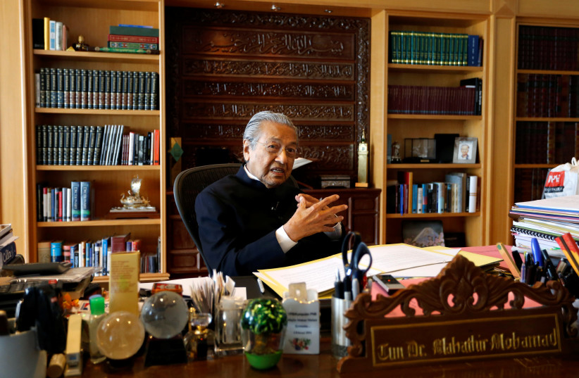 Mahathir Mohamad speaks during an interview in Putrajaya, Malaysia (photo credit: REUTERS)
