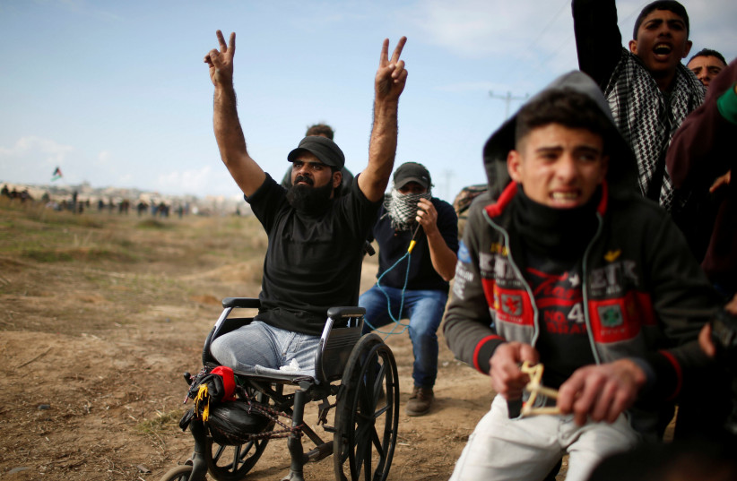 Ibraheem Abu Thuraya gestures during a protest against US President Donald Trump's decision to recognize Jerusalem as the capital of Israel, near the border with Israel in the east of Gaza City, December 15, 2017.  (photo credit: REUTERS)