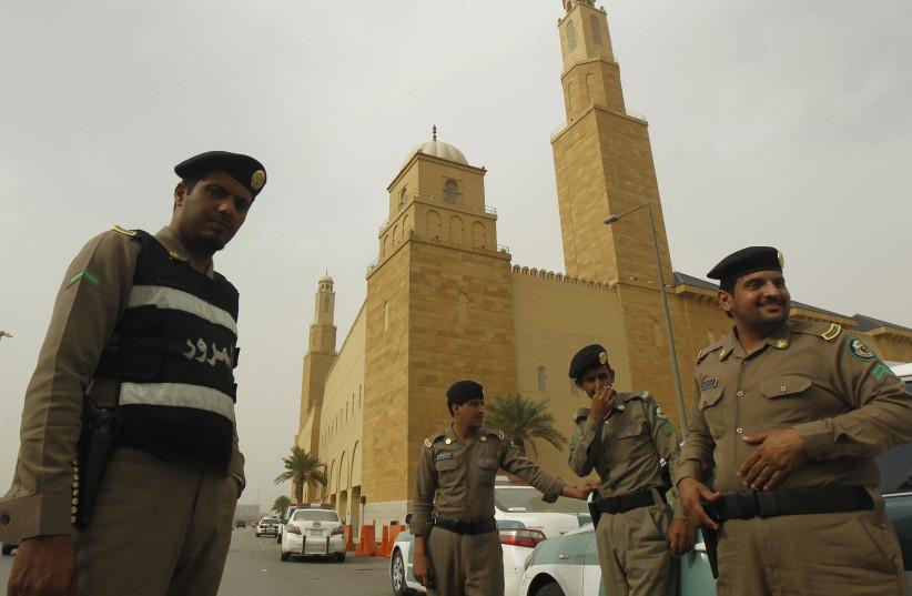 Policemen stand outside al Rajhi Mosque in Riyadh, Saudi Arabia, March 11, 2011. (photo credit: REUTERS)