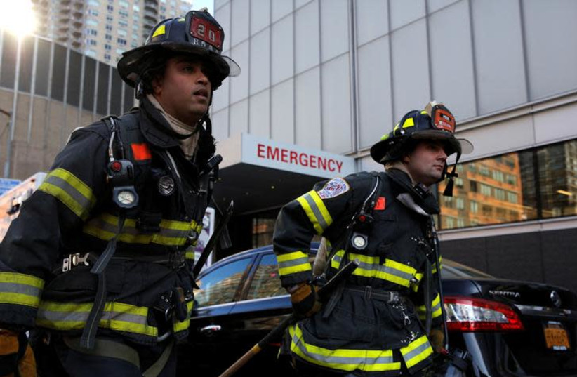 New York City firefighters (FDNY) at the scene of a fire at NYU Medical Center in Manhattan, New York City, U.S., December 14, 2016.  (photo credit: BRENDAN MCDERMID/REUTERS)