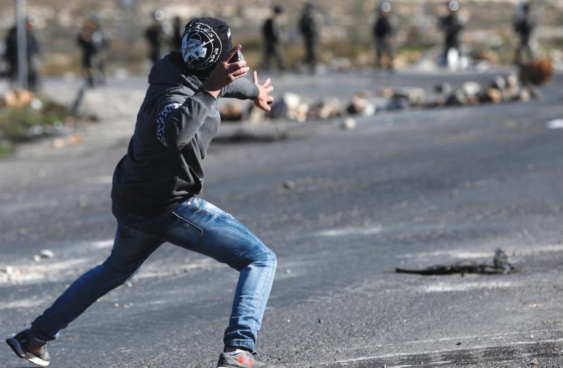 Israeli settlers throw rocks, Palestinians respond in West Bank clash
