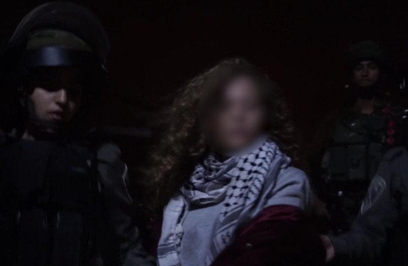 Palestinian teenager Ahed Tamimi is arrested by Israeli security forces, December 19, 2017 (photo credit: IDF SPOKESPERSON'S UNIT)