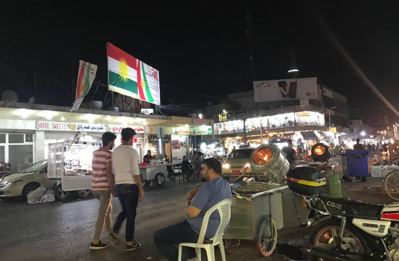 Kurds walk on a busy street in Erbil, the capital of the Kurdistan Regional Government.  (photo credit: SETH J. FRANTZMAN)