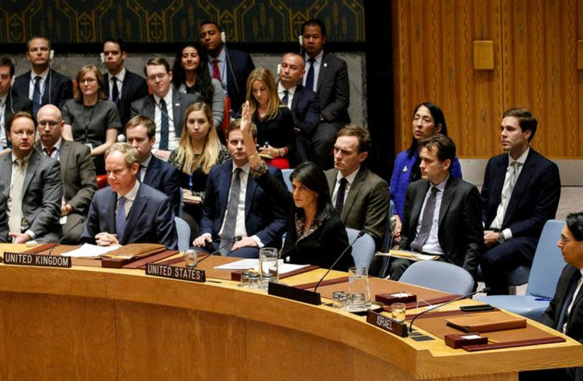 US Ambassador to the United Nations Nikki Haley vetos a resolution during the United Nations Security Council meeting on the situation in the Middle East, December 18, 2017 (photo credit: BRENDAN MCDERMID/REUTERS)