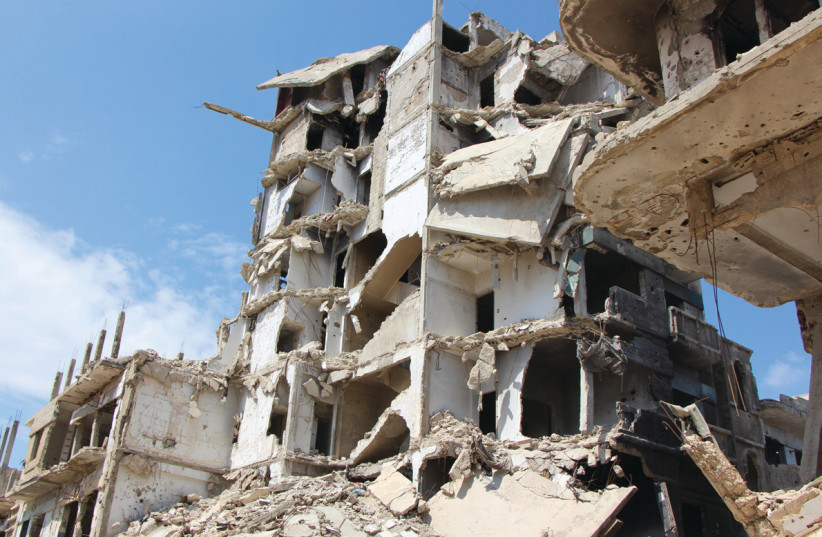 A BOMBED-OUT neighborhood of Homs, Syria, earlier this year (photo credit: Courtesy)