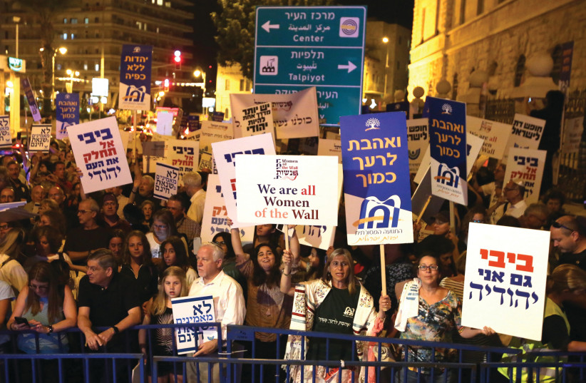 ACTIVISTS TAKE part in a demonstration in Jerusalem in July against legislation that would have strengthened the Chief Rabbinate's monopoly over conversion in Israel (photo credit: MARC ISRAEL SELLEM)
