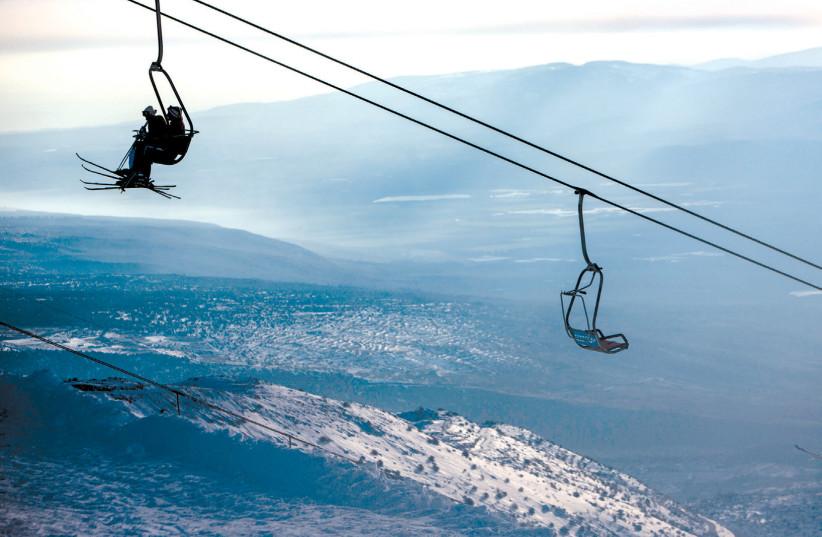 SKIERS RIDE a ski lift on Mount Hermon in the Golan Heights (photo credit: REUTERS/NIR ELIAS)