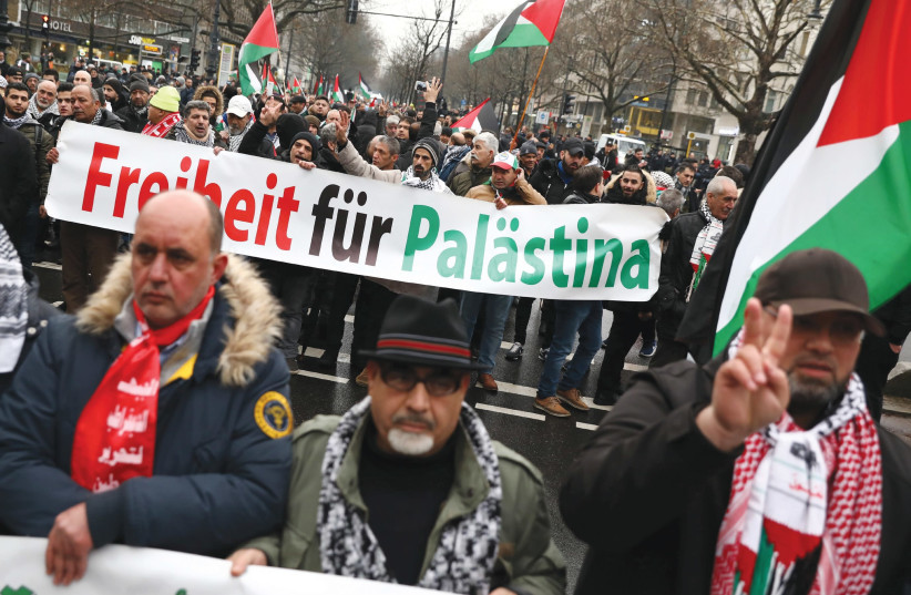 ANTI-ISRAEL PROTESTERS march during a demonstration in Berlin. (photo credit: REUTERS)