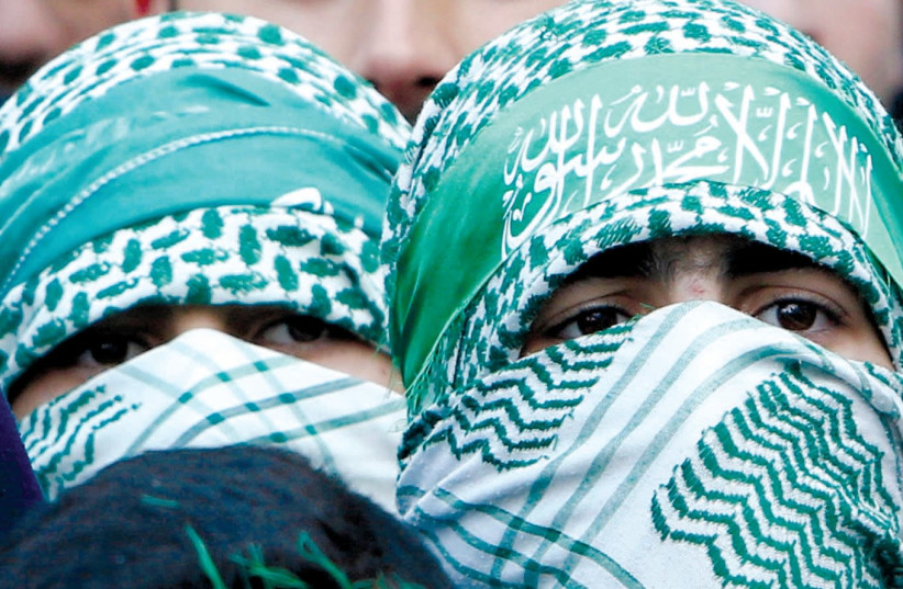 HAMAS SUPPORTERS take part in a rally in Nablus marking the 30th anniversary of the movement's founding. (photo credit: REUTERS)