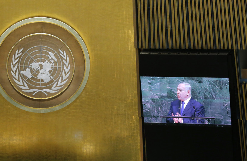 Israeli Prime Minister Benjamin Netanyahu is shown on a large screen as he addresses the 72nd United Nations General Assembly at UN headquarters in New York, US, September 19, 2017.  (photo credit: REUTERS)