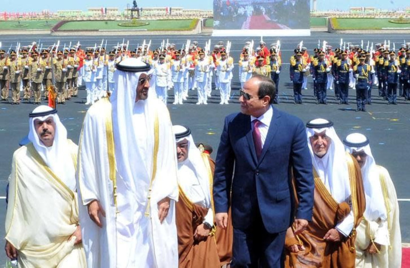 Egyptian President Abdel Fattah al-Sisi (front R) arrives with Arab leaders Sheikh Mohammed bin Zayed (front L), Crown Prince of Abu Dhabi, Salman Bin Hamad Al Khalifa, Crown Prince of Bahrain, and Prince Khalid Al-Faisal, Governor of Makkah Region, at the opening of the Mohamed Najib military base (photo credit: THE EGYPTIAN PRESIDENCY/HANDOUT VIA REUTERS)