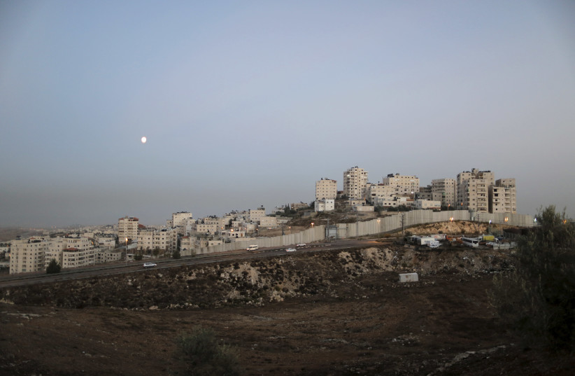 A general view picture shows the Israeli barrier running along the East Jerusalem refugee camp of Shuafat (photo credit: REUTERS)