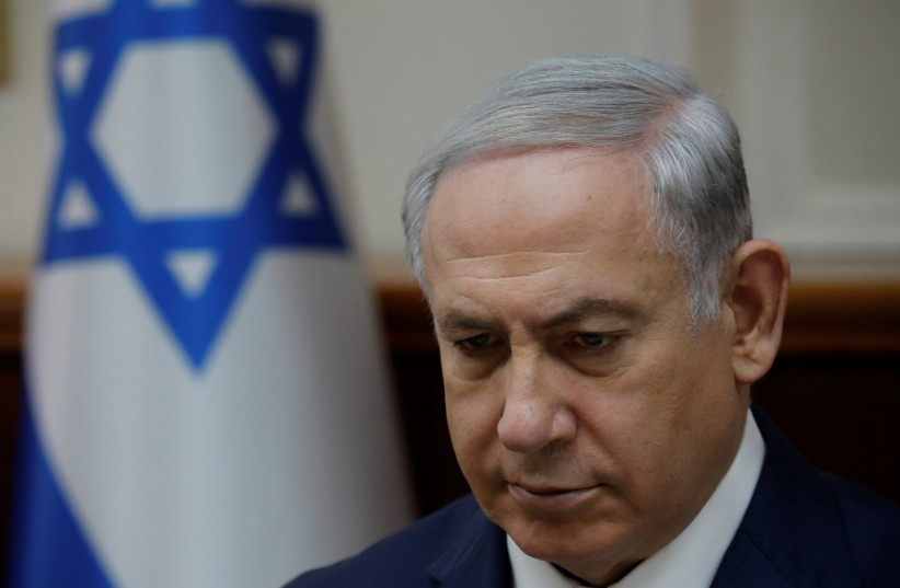 Israeli Prime Minister Benjamin Netanyahu attends the weekly cabinet meeting at the Prime Minister's office in Jerusalem (photo credit: AMIR COHEN/REUTERS)
