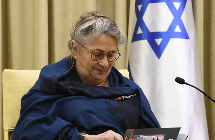 Nechama Rivlin looking through a graphic novel based on The Diary of Anne Frank. (photo credit: Mark Neiman/GPO)