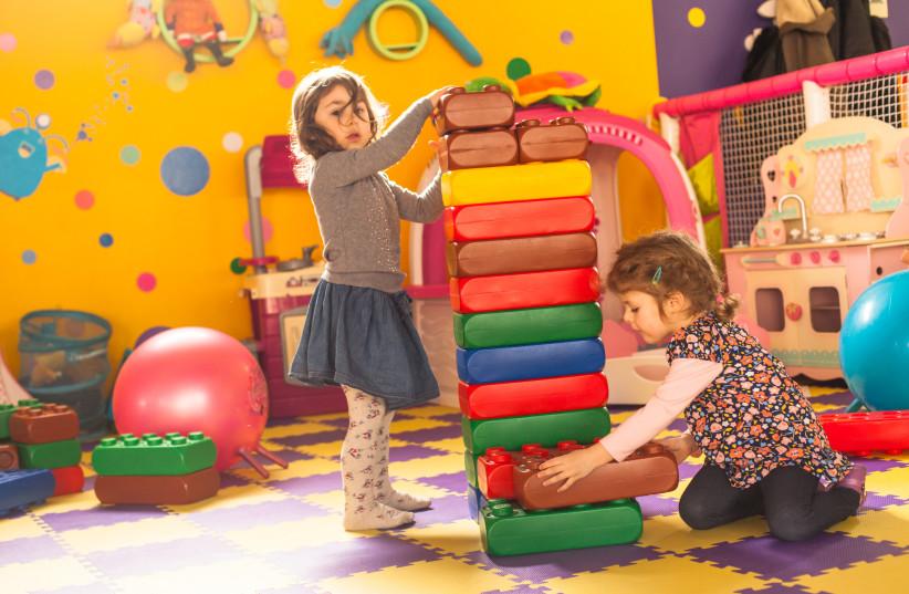 Two girls play (photo credit: INGIMAGE)