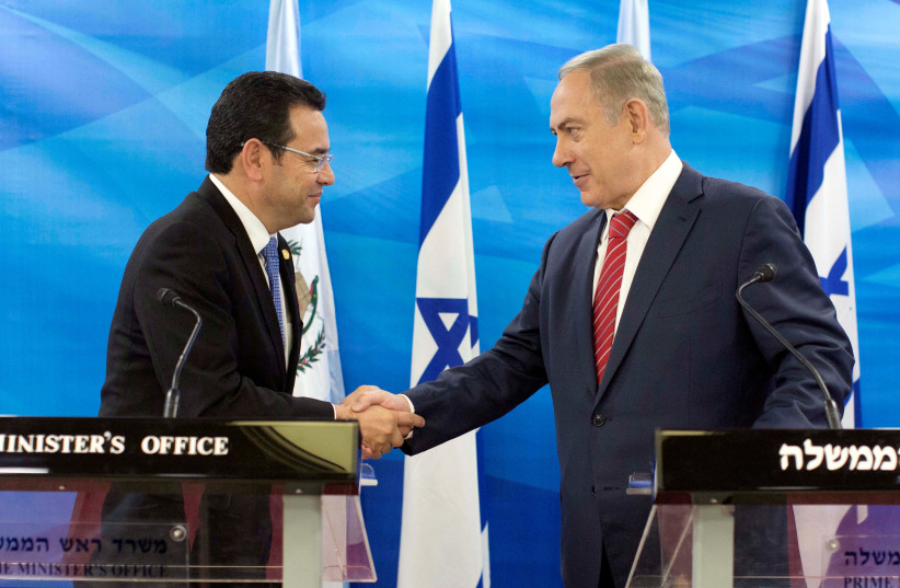 Guatemalan President Jimmy Morales and Israeli Prime Minister Benjamin Netanyahu shake hands as they deliver statements to the media during their meeting in Jerusalem, Israel. (photo credit: REUTERS)