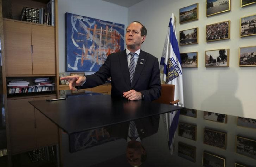 Nir Barkat, the mayor of Jerusalem, speaks during his interview with Reuters in his office at the Jerusalem Municipality April 24, 2017 (photo credit: REUTERS/Ronen Zvulun)