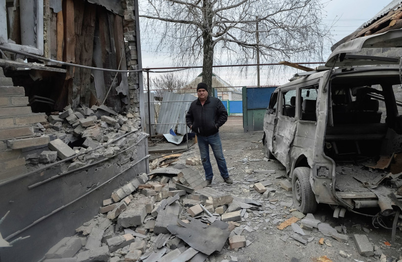 A MAN inspects his house, which was damaged by recent shelling, in the government-held village of Novoluhanske, Ukraine. (photo credit: REUTERS)