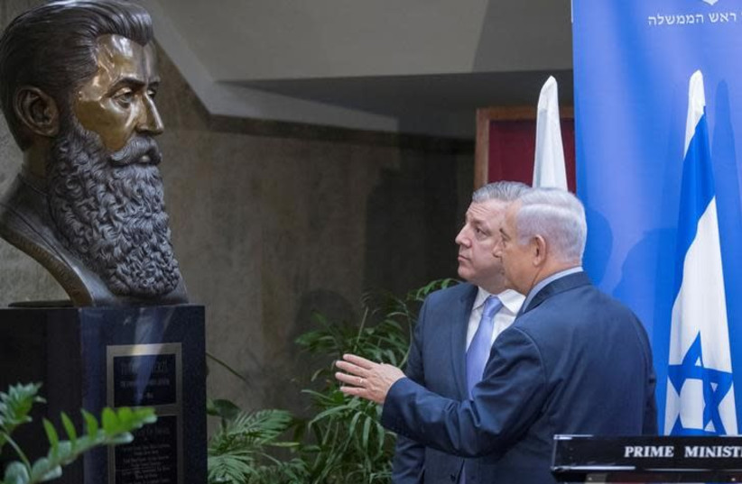 Israeli Prime Minister Benjamin Netanyahu (R) meets Georgian Prime Minister Giorgi Kvirikashvili in his office in Jerusalem July 24, 2017 (photo credit: REUTERS/JACK GUEZ)