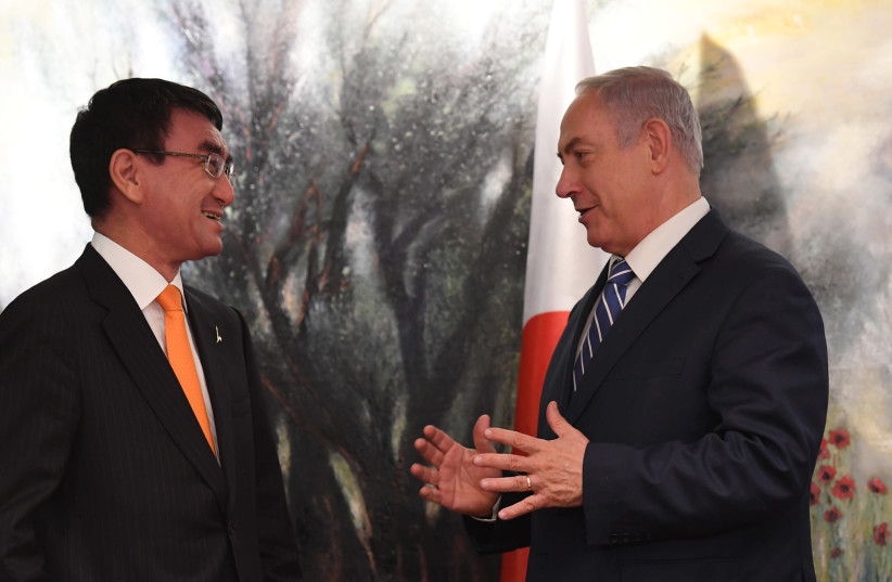 Israeli Prime Minister Benjamin Netanyahu (R) meets Japan's Foreign Minister Taro Kono (L) (photo credit: KOBY GIDEON/GPO)