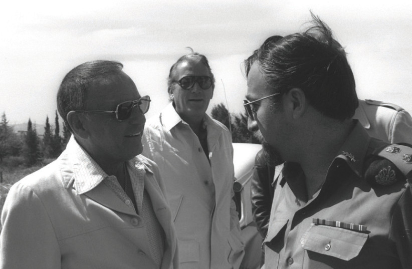 Frank Sinatra (left) and Gregory Peck talk to an IDF officer in Jerusalem in 1978, when he opened the Frank Sinatra Center at the Hebrew University's Mount Scopus campus (photo credit: MOSHE MILNER / GPO)