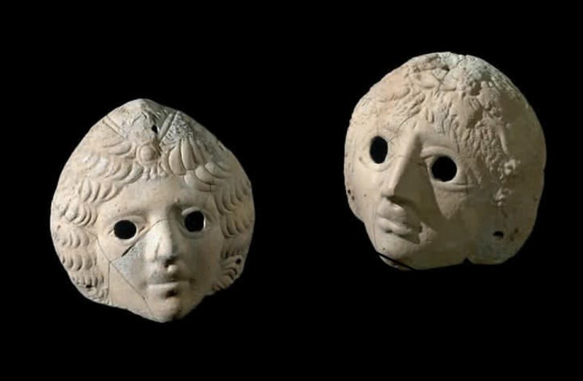 Masks of Dionysus and Ariadne uncovered at the Castra site. (photo credit: CLARA AMIT/IAA)