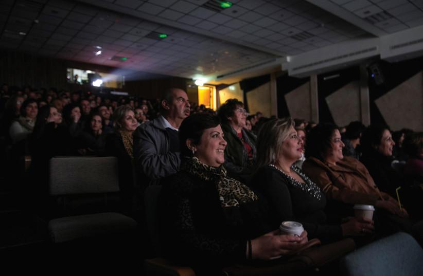 PEOPLE WATCH a screening of Arab Israeli film, 'In Between', at a cinema in Nazareth. (photo credit: REUTERS)
