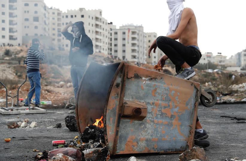 Extremists burning trash.  (photo credit: REUTERS)