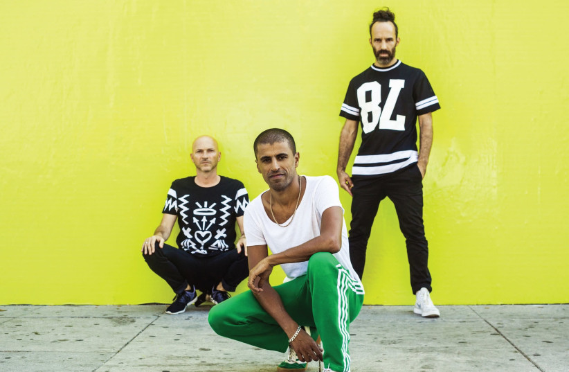 'In every album album, we give ourselves the license to address the things we are going through in the moment and also push the envelope of what's expected of us,' says Balkan Beat Box saxophonist Ori Kaplan (left), seen here with the rest of the band (photo credit: ZIV SADE)