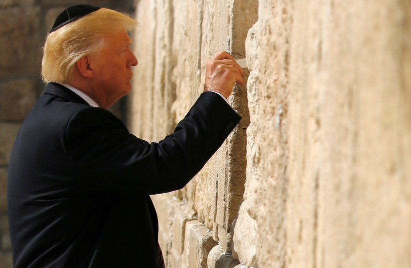 US President Donald Trump leaves a note at the Western Wall, Judaism's holiest prayer site, in Jerusalem's Old City May 22, 2017 (photo credit: RONEN ZVULUN / REUTERS)
