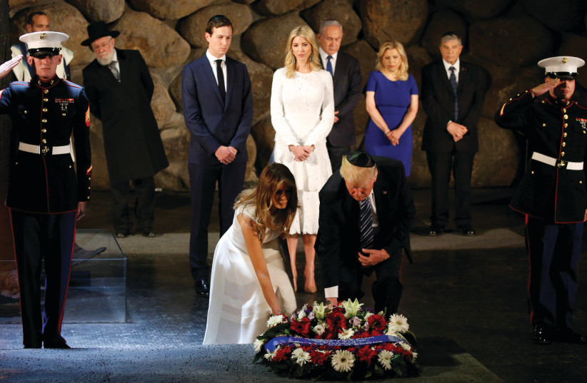 US PRESIDENT Donald Trump and First Lady Melania lay a wreath in the Hall of Remembrance at Yad Vashem in Jerusalem during a ceremony in May commemorating the Holocaust as Jared Kushner and his wife Ivanka, and PM Benjamin Netanyahu and his wife, Sara, look on (photo credit: JONATHAN ERNST / REUTERS)