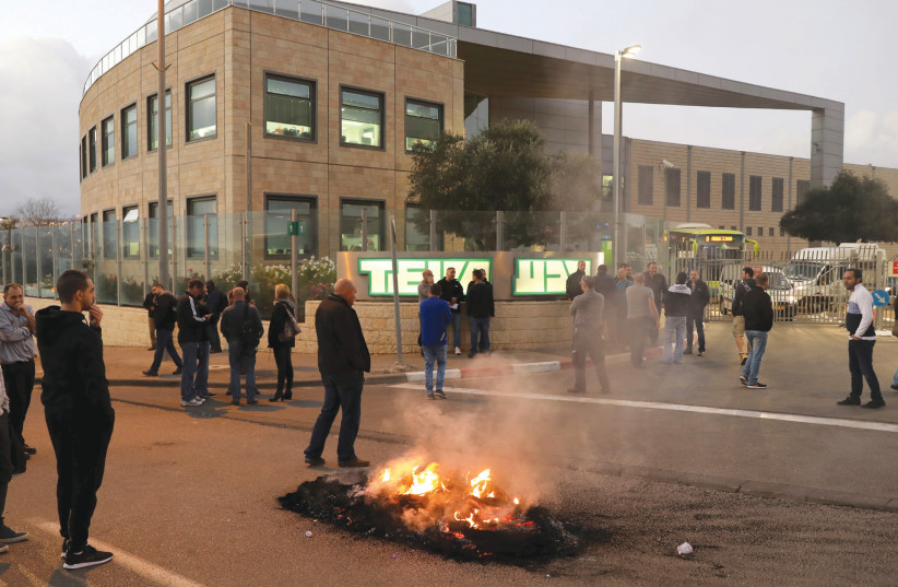 People protest outside a Teva Pharmaceutical Industries facility in Jerusalem on December 14 (photo credit: AMMAR AWAD/REUTERS)