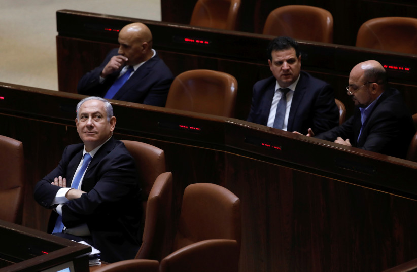 Prime Minister Benjamin Netanyahu attends a session of the Knesset, the Israeli parliament, in Jerusalem in 2017. (photo credit: RONEN ZVULUN / REUTERS)