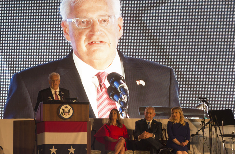 US Ambassador to Israel David Friedman (L) speaks during a Fourth of July celebration at his residence in Herzilya Pituah on July 3, 2017.  (photo credit: HEIDI LEVINE / POOL / AFP)