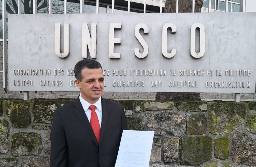 Carmel Shama-Hacohen standing in front of the UNESCO office with the unaccepted letter  (photo credit: ISRAELI DELEGATION TO UNESCO)