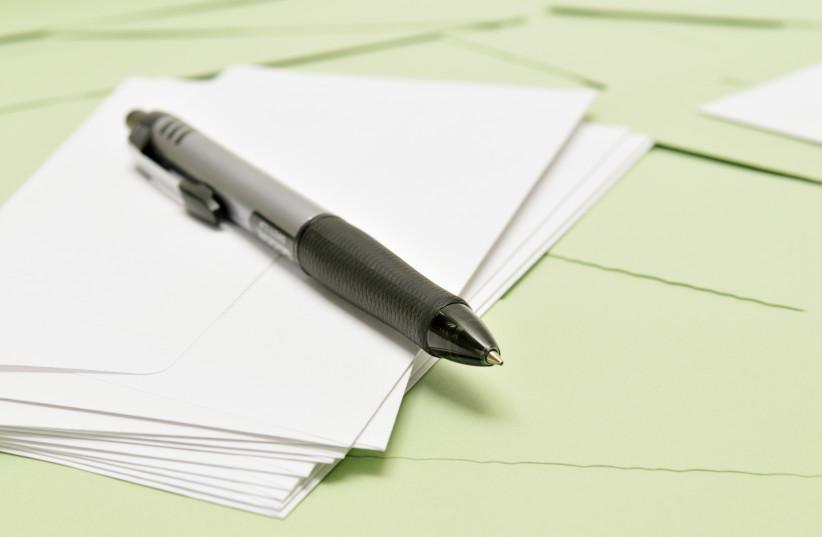 Pen and paper (illustrative). (photo credit: INGIMAGE)