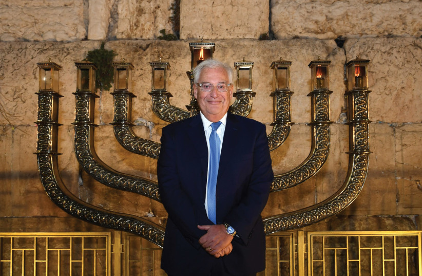 US Ambassador to Israel David Friedman stands at the Western Wall after lighting the menorah there for the second night of Hanukkah, 2018 (photo credit: Courtesy)