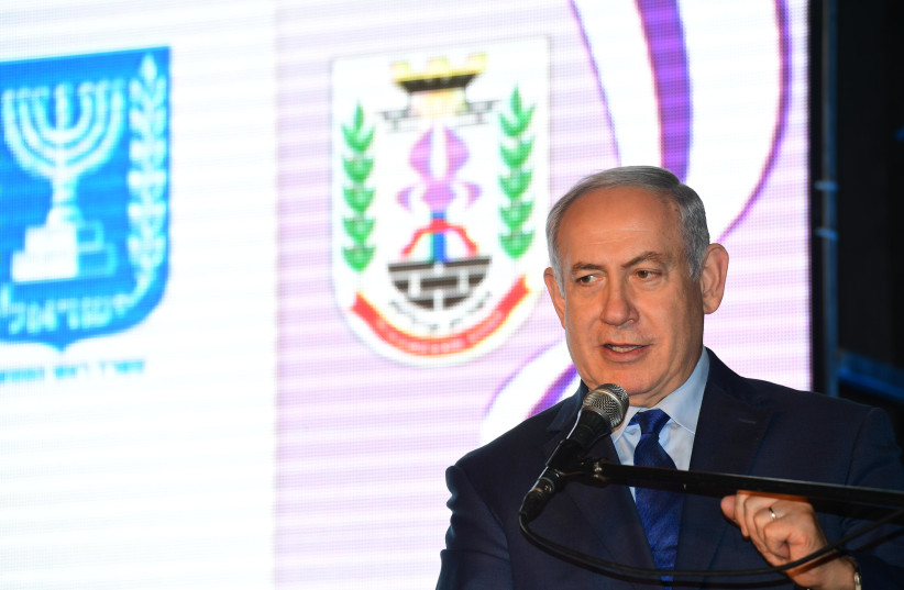 Prime Minister Benjamin Netanyahu at the signing ceremony of a comprehensive agreement in Nazareth Illit, December 28, 2017. (photo credit: AMOS BEN GERSHOM, GPO)