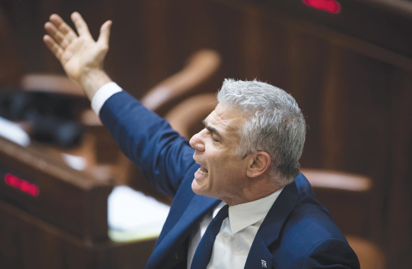Yesh Atid chairman Yair Lapid declaims during the filibuster on Wednesday night, ahead of the Knesset vote on the Police Recommendations Bill (photo credit: HADAS PARUSH/FLASH90)