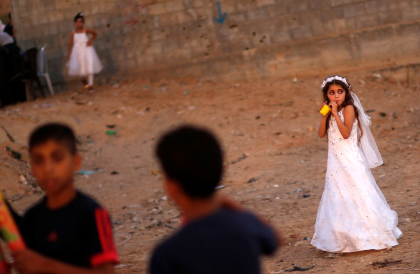 A Palestinian girl attends a mass wedding in Gaza, July 2016 (photo credit: MOHAMMED SALEM/ REUTERS)