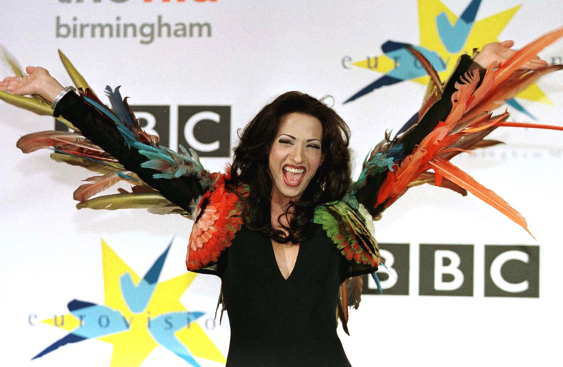 Israel's transsexual Dana International celebrates winning the Eurovision Song contest at the National Indoor Arena in Birmingham, England. (photo credit: REUTERS)