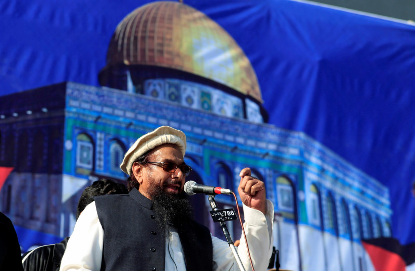 Hafiz Muhammad Saeed (C), chief of the Islamic charity organisation Jamaat-ud-Dawa (JuD), speaks to supporters during a gathering to protest against Trump's decision to recognise Jerusalem as the capital of Israel, in Rawalpindi, Pakistan December (photo credit: REUTERS/FAISAL MAHMOOD)