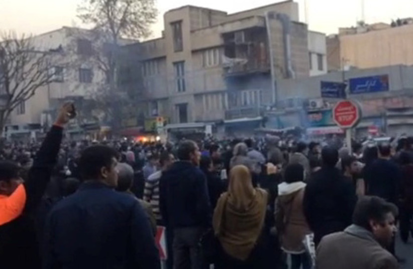 People protest in Tehran, Iran December 30, 2017 in this still image from a video obtained by REUTERS (photo credit: REUTERS)