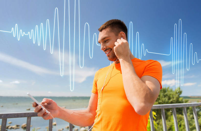 A runner listening to a podcast. (Illustrative) (photo credit: INGIMAGE)