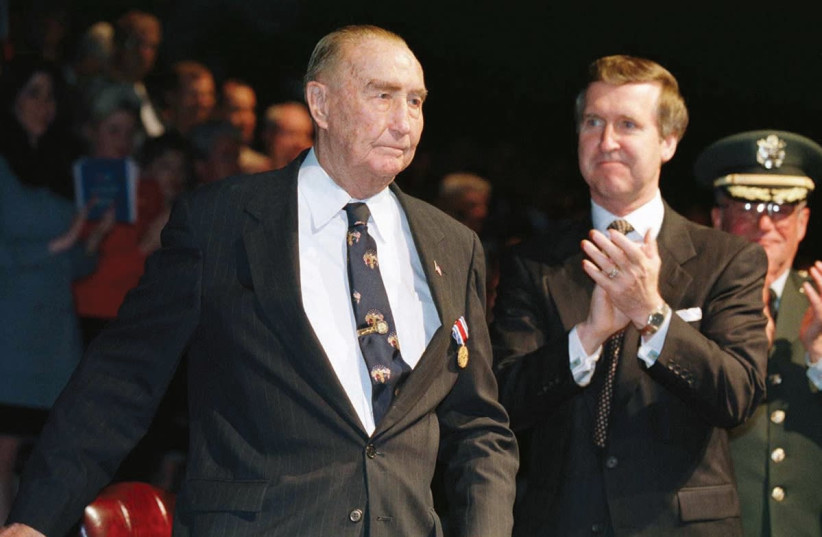 FORMER US SENATOR Strom Thurmond (left) is applauded at a ceremony in his honor in 1997. (photo credit: LUC NOVOVITCH/REUTERS)
