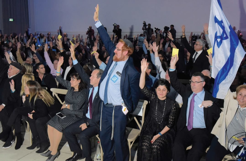 LIKUD CENTRAL COMMITTEE members vote to endorse exercising Israel's sovereignty over Judea and Samaria last night at Airport City. (photo credit: AVSHALOM SHOSHANI)