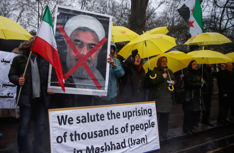 Opponents of Iranian President Hassan Rouhani hold a protest outside the Iranian embassy in west London. (photo credit: REUTERS)